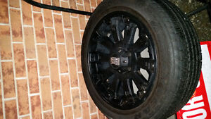 XD series 20 inch black ris and tires