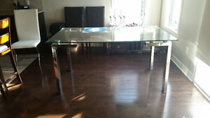 ASHLEY GLASS DINNING TABLE NEVER USED