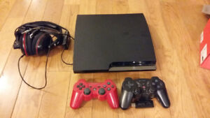 PS3 slim with 2 controllers, headset and games