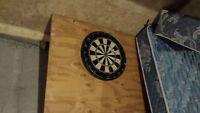 Solid dart board mounted to wood backing $20.00