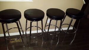 4 leather bar stools. Great condition.