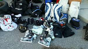 Goalie pads, gloves, skates and armour.  assorted sizes