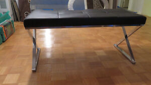 Black faux leather bench with chrome legs