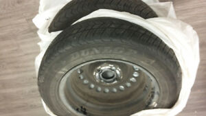 Set of 4  Mud and Snow Tires, on rims