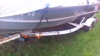16 foot alum boat with trailer and 20 horse merc