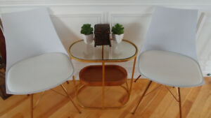 White Chairs and Side Table with Gold Trim