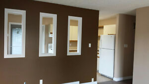 Clean and updated 2 bedroom main floor house with yard and deck