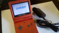 GBA SP Rouge Flamme + chargeur officiel