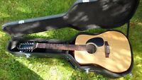 Simon and Patrick 12 String Acoustic Guitar $250.