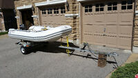 zodiac dinghy with 9.8 outboard and trailer