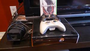 Black Xbox 360 Slim for sale