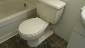 Floor based wall connected toilet