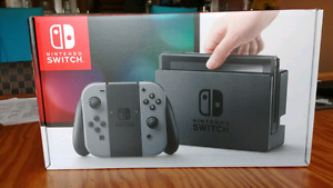 Unopened Nintendo Switch with Gray Joy Cons