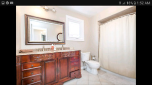 Selling double sink vanity with faucet and mirror