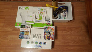Nintendo Wii with Wii Fit board and other accessories