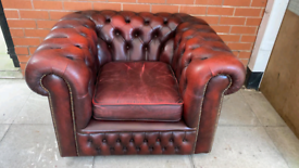 An Oxblood Red Leather Chesterfield Club/Armchair