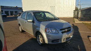 2010 Chevrolet Aveo LS AND Snow tires on mounted rims