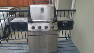 old BBQ for Sale - it comes with a stove and some kitchen tool