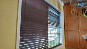 White and brown wood blind