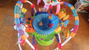 Baby Einstein exersaucer with lots of extra toys