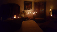 Candle-lit relaxation massage in a comfy home setting