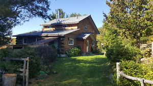 Maintained log home with a private beach and cottage for sale!
