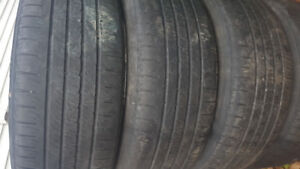 18 inch Dodge Avenger rims with all season tires and almost new