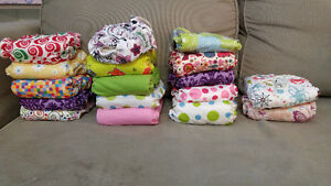 32 cloth diapers. 64 liners
