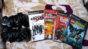 Ps2 games and 2 sony controllers