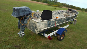 Duck boat motor and trailer