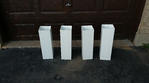 four plastic support posts