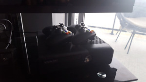 Xbox 360 w/ two controllers and game