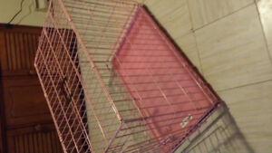Cute pink dog kennel for sale.  Good for medium sized dog