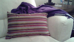 Purple throw with accent pillow