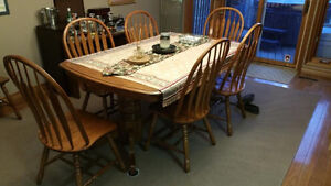 Solid oak dining table with built-in extension and 8 chairs Kawartha Lakes Peterborough Area image 4