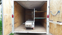 Gutter machine with enclosed trailer