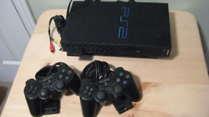 Sony PS2 with controllers and games