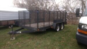 7 x 14 dual wheel trailer with 4 foot wire cage for rent