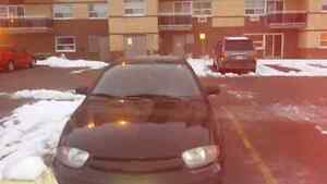 2003 black 2 door coupe  style cavilier With newer parts/battery Peterborough Peterborough Area image 2