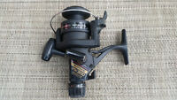 Two Shimano FX300 spinning reels - one used and one BNIB!