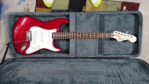 Like new Fender Squire in Red, Hard case and 4 Guitar stand