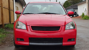 Extremely rare 6MT SE-R Code Red Altima. Trade for automatic.