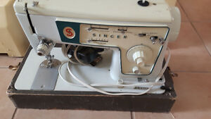 Singer sewing machine with case 75.00