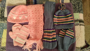 Knitted hat-scarfs-mitts sets.