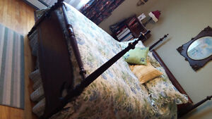 Antique four poster double bed