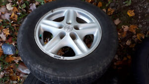 4 rims and one good winter tire 215-65-16 off rav4