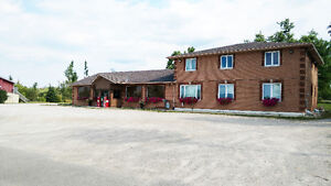 BUILDING & BUSINESS ON 1.69 ACRES WITH 2 APARTMENTS!!!