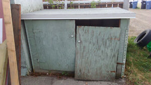 Sturdy building, new roof, used to store garbage bins.