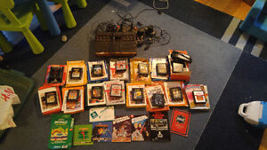 Selling Attari 2600 plus a bunch of games and stuff