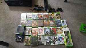 Xbox 360 with 27 games plus 2 controllers